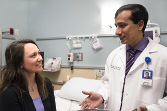 Dr. Naveen Gowda, St. Luke's interventional radiologist, talks with his patient Britt Johnson